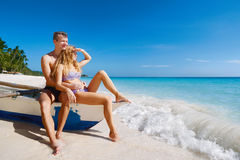 Happy Romantic Couple Watching the Sun on Tropical Beach Vacatio Stock Photography