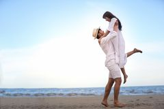 Happy Romantic Couples lover holding hands together walking on t stock image