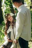 Happy romantic family, pregnant wife in vintage dress holding ha stock images
