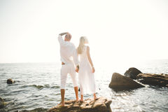 Happy romantic fashion couple in love have fun on beautiful sea at summer day Stock Photos