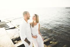 Happy romantic fashion couple in love have fun on beautiful sea at summer day.  Royalty Free Stock Image