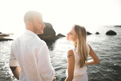 Happy romantic fashion couple in love have fun on beautiful sea at summer day.  Royalty Free Stock Photo