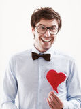Happy Romantic man with a red heart in his hand Royalty Free Stock Photography