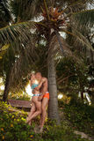 Happy romantic man and woman in love kissing on beach at summer day Royalty Free Stock Image