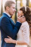 Happy romantic newly married couple before the kiss in the autumn pine forest Stock Photos