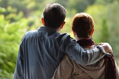 Happy romantic senior couple looking at the green nature Stock Image