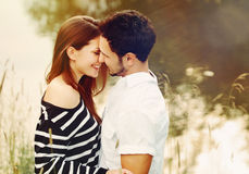 Happy romantic sensual couple in love on summer vacation. Happy romantic sensual couple in love together outdoors on summer vacation royalty free stock image