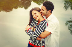 Happy romantic wide smile couple in love at the lake outdoor on. Vacation, beauty of nature, harmony concept Royalty Free Stock Photos