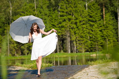 Happy romantic woman with parasol in sunlight Stock Photos
