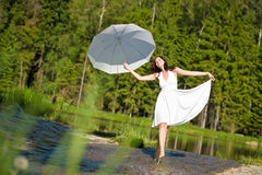 Happy romantic woman with parasol in sunlight Royalty Free Stock Photography
