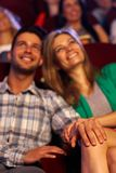 Happy romantic young couple in cinema royalty free stock image
