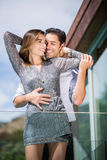 Happy romantic young couple embracing stock images
