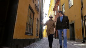 Happy run together in old city street stock video footage