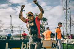 Happy runner raising arms after finish a extreme obstacle race Royalty Free Stock Photography