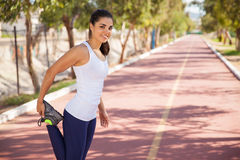 Happy runner warming up stock images