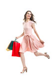 Happy running beautiful woman with many shopping bags Stock Photo
