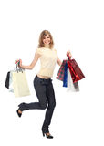 Happy running  blonde with paper bags Royalty Free Stock Photo