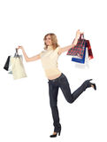 Happy running  blonde with paper bags Royalty Free Stock Photos