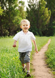 Happy running boy Stock Images