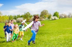 Happy running children with big white airplane toy Royalty Free Stock Photo
