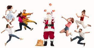 Happy running Christmas people over white background stock images