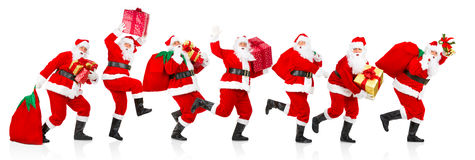 Happy running Christmas Santas. Happy running Christmas Santa. Isolated over white background royalty free stock images
