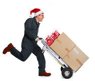 Happy running Delivery man with pacages. Delivery man with boxes. Express Christmas shipping Stock Photos