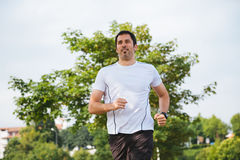 Happy running man. Happy and attractive running man outdoors Royalty Free Stock Photos