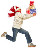 Happy running man with Xmas gifts Stock Images