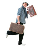 Happy running traveller with vintage suitcases. Happy running young male traveller with two old vintage suitcases isolated on white background Royalty Free Stock Images