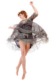 Happy running woman. Happy jumping woman in beautiful dress isolated over white background Royalty Free Stock Images