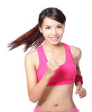 Happy Running woman on white. Runner woman isolated. Running fit fitness sport model jogging smiling happy isolated on white background. model is a asian girl Royalty Free Stock Photos