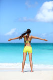 Happy running woman winning - fitness success. Happy running woman winning - fitness goal concept on beach. Young Asian female runner serene and blissful Royalty Free Stock Photography