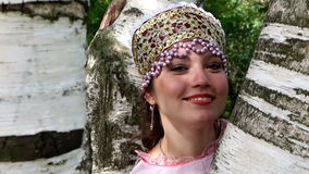 Happy russian girl in folk costume and birch stock footage