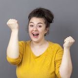 Happy 20s big woman expressing fun victory Stock Photos