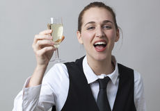Happy 20s girl drinking too much bubbly wine at party to celebrate success Stock Photos