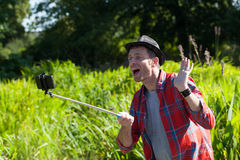 Happy 40s man having fun with outdoors self-portraits Stock Photography