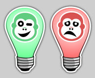 Happy and sad bulb Royalty Free Stock Image