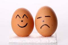 Happy & Sad Egg in Isolated White Background Stock Photography