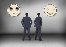 Happy or sad emoticon face with Businessman looking in opposite directions Royalty Free Stock Photography