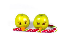 Happy and sad emoticons apple licking a lollipop. Feelings, attitudes and emotions. Stock Photography