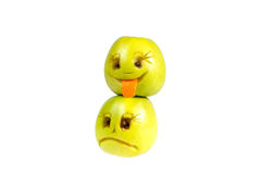 Happy and sad emoticons from apples. Feelings, attitudes  Stock Image