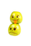 Happy and sad emoticons from apples. Feelings, attitudes Stock Images
