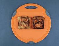 Happy and sad toast Royalty Free Stock Image