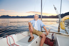 Happy sailing man boat Royalty Free Stock Image
