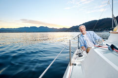 Happy sailing man boat Royalty Free Stock Photo