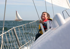 Happy sailor. Young boy with ocean spray on him showing his joy of sailing Stock Photos