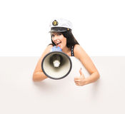Happy sailor girl with a megaphone and a banner Royalty Free Stock Photos