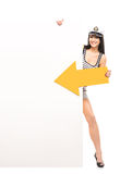 Happy sailor woman with an arrow and a blank banner Royalty Free Stock Image
