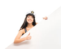 Happy sailor woman with a banner holding thumbs up Stock Photography